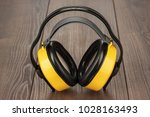 hearing protection yellow ear... | Shutterstock . vector #1028163493