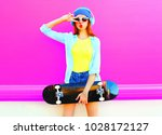 fashion cool girl with a... | Shutterstock . vector #1028172127