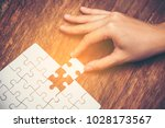 close up of hand placing the... | Shutterstock . vector #1028173567