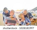 happy senior friends having fun ... | Shutterstock . vector #1028181997