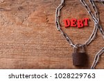 debt of red letters near the... | Shutterstock . vector #1028229763