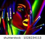disco dancer in neon light.... | Shutterstock . vector #1028234113