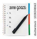 Small photo of 2018 Goals List in Notepad Isolated on White Background. Top View. Notepad with Bookmarks. Glossy Black Marker. Bookmark Blue, Red and Green. Bold Text.