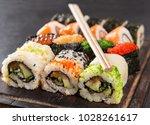 japanese sushi over black... | Shutterstock . vector #1028261617