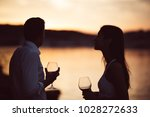 two young people enjoying a... | Shutterstock . vector #1028272633