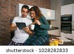couple having breakfast in the... | Shutterstock . vector #1028282833