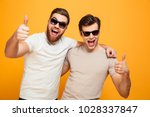 portrait of a two cheerful... | Shutterstock . vector #1028337847