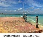 old pier on the empty beach ... | Shutterstock . vector #1028358763