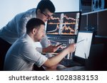 team of stockbrokers are having ... | Shutterstock . vector #1028383153