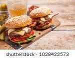 two cheeseburgers on sesame... | Shutterstock . vector #1028422573