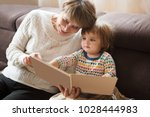 grandmother reading a tale to...   Shutterstock . vector #1028444983