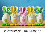 colored easter eggs bunny ... | Shutterstock . vector #1028455147