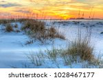 a colorful sunset over the... | Shutterstock . vector #1028467177