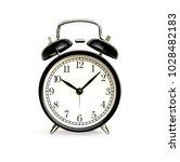 front of black alarm clock... | Shutterstock . vector #1028482183