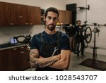 worker standing with folded... | Shutterstock . vector #1028543707