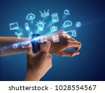 close up female hand with... | Shutterstock . vector #1028554567