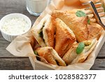 puff pastry triangles filled... | Shutterstock . vector #1028582377