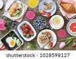 breakfast food table. festive... | Shutterstock . vector #1028598127