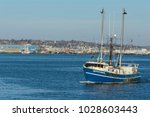 Small photo of New Bedford, Massachusetts, USA - February 19, 2018: Fishing vessel Adventuress leaving New Bedford harbor