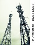 communication transmitter towers | Shutterstock . vector #1028612317