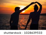 romantic couple dancing on the... | Shutterstock . vector #1028639533