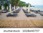 sun loungers on a beach in... | Shutterstock . vector #1028640757