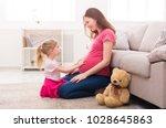 little girl touching her... | Shutterstock . vector #1028645863