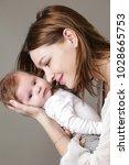 mother holding her newborn baby    Shutterstock . vector #1028665753