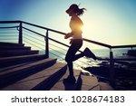 sporty fitness female runner... | Shutterstock . vector #1028674183