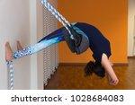 iyengar female yogi in blue... | Shutterstock . vector #1028684083
