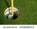 golf ball close up on green in... | Shutterstock . vector #1028688613