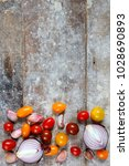 garlic  red onions and tomatoes ... | Shutterstock . vector #1028690893
