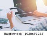 business man hands holding a... | Shutterstock . vector #1028691283