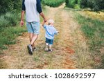 father and son walking on... | Shutterstock . vector #1028692597
