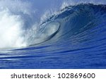 Tropical wave barrel in the ocean in Fiji - stock photo