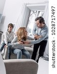 reluctance. upset little boy... | Shutterstock . vector #1028717497