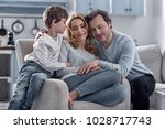 hugging. peaceful calm smiling... | Shutterstock . vector #1028717743