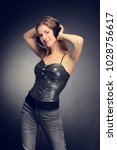 young cheerful girl listening... | Shutterstock . vector #1028756617
