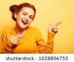 portrait of a pretty redhair ... | Shutterstock . vector #1028806753