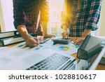 working project managers... | Shutterstock . vector #1028810617