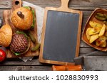 tasty grilled home made burgers ... | Shutterstock . vector #1028830993