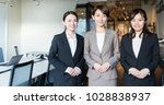 Small photo of Three asian woman in the office.