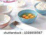 cook prepare bakery material on ... | Shutterstock . vector #1028858587