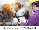 industry 4.0 robot concept ... | Shutterstock . vector #1028889433
