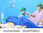 asian male obstetrician and...   Shutterstock . vector #1028902813