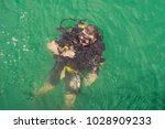 divers on the surface of water... | Shutterstock . vector #1028909233