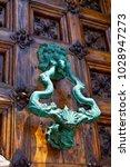 beautiful knocker on the door... | Shutterstock . vector #1028947273