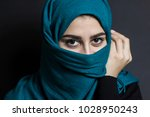 portrait of a muslim girl with... | Shutterstock . vector #1028950243