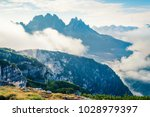 foggy summer view of gruppo del ... | Shutterstock . vector #1028979397