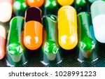 medicine pills or capsules on... | Shutterstock . vector #1028991223